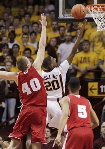 Minnesota's Austin Hollins (20) scores as Wisconsin's Jared Berggren (40) defends during the first half of an NCAA college basketball game Thursday, Feb. 9, 2012, in Minneapolis. (AP Photo/Genevieve Ross)