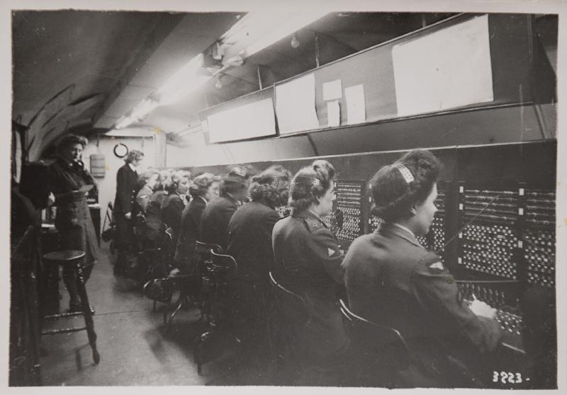 A reproduction of a black and white photograph taken in 1944 and shown to AFP by former D-Day switchboard operator Marie Scott, shows women at work in the tunnels at Fort Southwick in Portsmouth, southern England. (AFP Photo/HO)