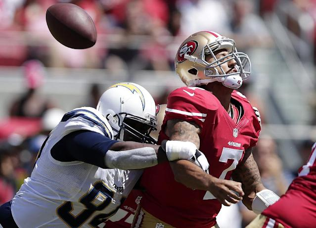 San Francisco 49ers quarterback Colin Kaepernick (7) loses the ball as he is hit by San Diego Chargers defensive end Corey Liuget during the first quarter of an NFL preseason football game in Santa Clara, Calif., Sunday, Aug. 24, 2014. The 49ers retained possession when it was ruled an incomplete pass. (AP Photo/Marcio Jose Sanchez)
