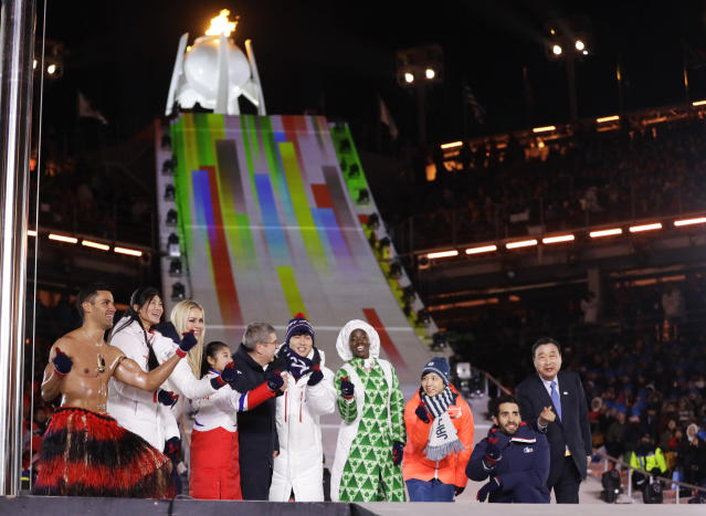 <p>Athletes from various nations including Pita Taufatofua, of Tonga, at left, United States' Lindsey Vonn, third from left, and Thomas Bach, president of the International Olympic Committee, fifth from left, pose during the closing ceremony of the 2018 Winter Olympics in Pyeongchang, South Korea, Sunday, Feb. 25, 2018. (AP Photo/Kirsty Wigglesworth) </p>