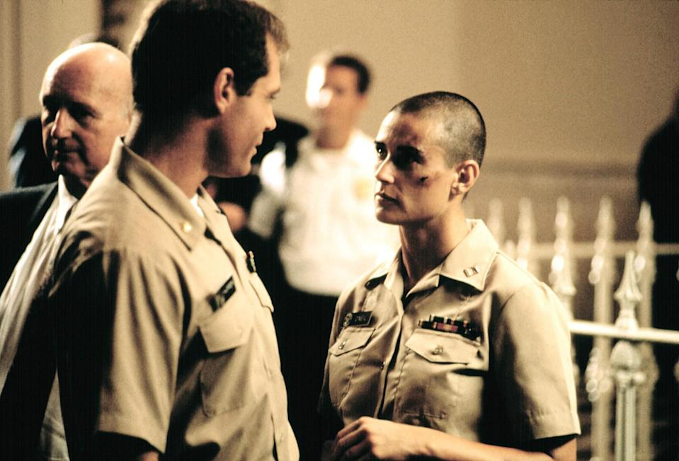 <p>Moore famously shaved her head for her role in <em>G.I. Jane</em>. The film is coming up on its 20-year anniversary on August 22. (Photo: Everett Collection) </p>