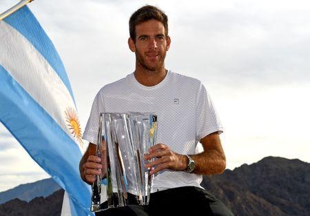 Mar 18, 2018; Indian Wells, CA, USA; Juan Martin Del Potro poises with the championship trophy after defeating Roger Federer (not pictured) in the men's finals in the BNP Paribas Open at the Indian Wells Tennis Garden. Mandatory Credit: Jayne Kamin-Oncea-USA TODAY Sports