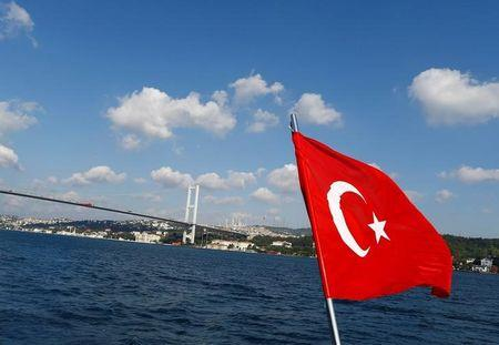 A Turkish flag is pictured on a boat with the Bosphorus bridge in the background in Istanbul