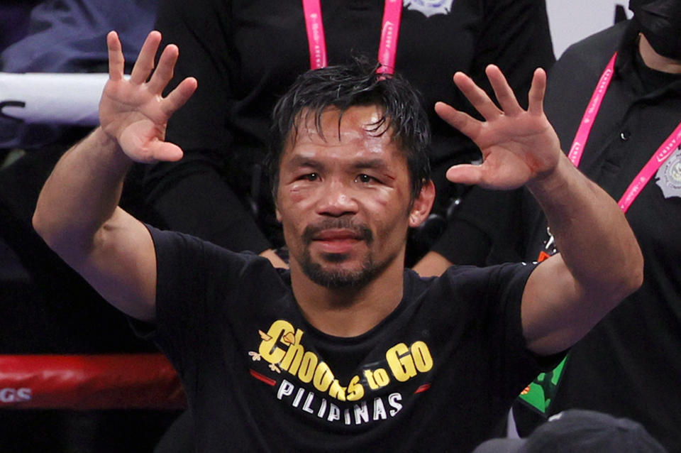 Manny Pacquiao (pictured) gestures to fans after his WBA welterweight title fight against Yordenis Ugas.
