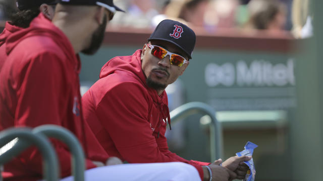 Boston Red Sox right fielder Mookie Betts, right, talks with pitcher David Price during the second inning of a baseball game against the San Francisco Giants at Fenway Park in Boston, Thursday, Sept. 19, 2019. (AP Photo/Charles Krupa)