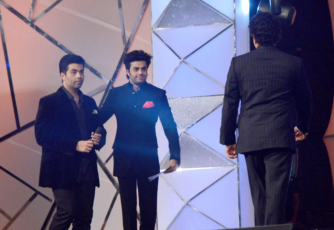 Film-maker Karan Johar, actor Manish Paul with Sachin Tendulkar at the 2014 Umang Police Show in Mumbai, January 20, 2014.