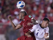 Panama's Alfredo Stephens, left, and United States´ Tyler Adams head the ball during a qualifying soccer match for the FIFA World Cup Qatar 2022 at Rommel Fernandez stadium, in Panama city, Panama, Sunday, Oct. 10, 2021. (AP Photo/Arnulfo Franco)