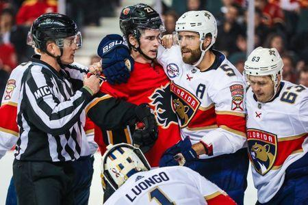 Jan 11, 2019; Calgary, Alberta, CAN; Calgary Flames center Sean Monahan (23) and Florida Panthers defenseman Aaron Ekblad (5) exchanges words during the third period at Scotiabank Saddledome. Calgary Flames won 4-3. Mandatory Credit: Sergei Belski-USA TODAY Sports