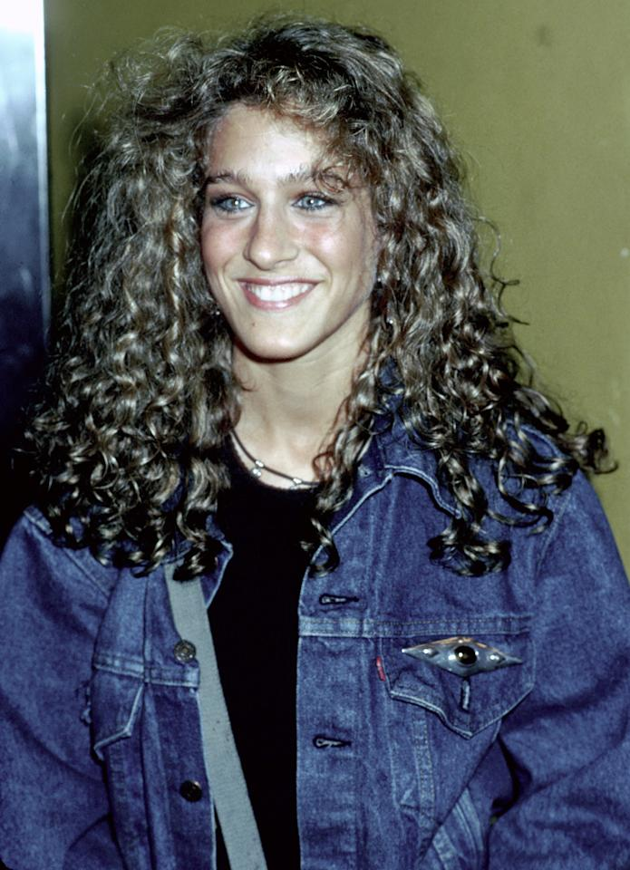 <p>Actress Sarah Jessica Parker lets her hair down in Los Angeles in 1980. She's also wearing a denim jacket and her eyebrows are roaming free.</p>