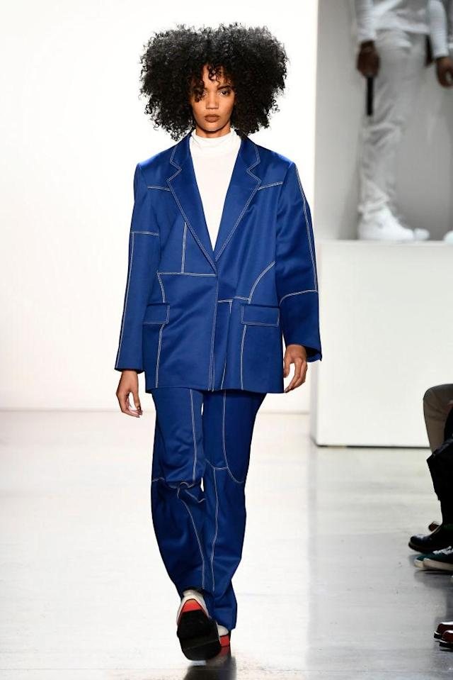 <p>Model wears a blue pantsuit at the fall 2018 Pyer Moss show. (Photo: Getty Images) </p>