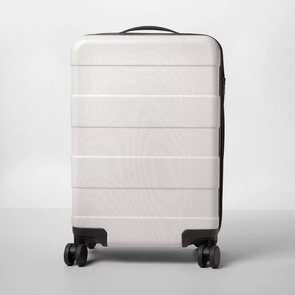 <p>This elegant-looking matte suitcase has everything that the fancy brands have but at a fraction of the cost. The expandable sides allow for more storage, while swivel wheels make for stress-free maneuvering. Plus, it comes in six pretty colorways, each of which will complement any travel look.</p>