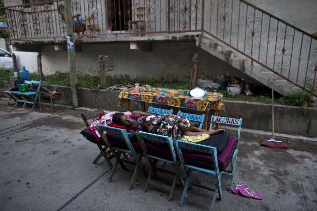 <p>A young woman laughs as she talks with neighbors from her makeshift bed on the street outside her earthquake damaged home in Juchitan, Oaxaca state, Mexico, Saturday, Sept. 9, 2017. The 8.1 quake off the southern Pacific coast just before midnight Thursday toppled hundreds of buildings in several states. Hardest-hit was Juchitan, where a third of the city's homes collapsed or were uninhabitable. (AP Photo/Rebecca Blackwell) </p>