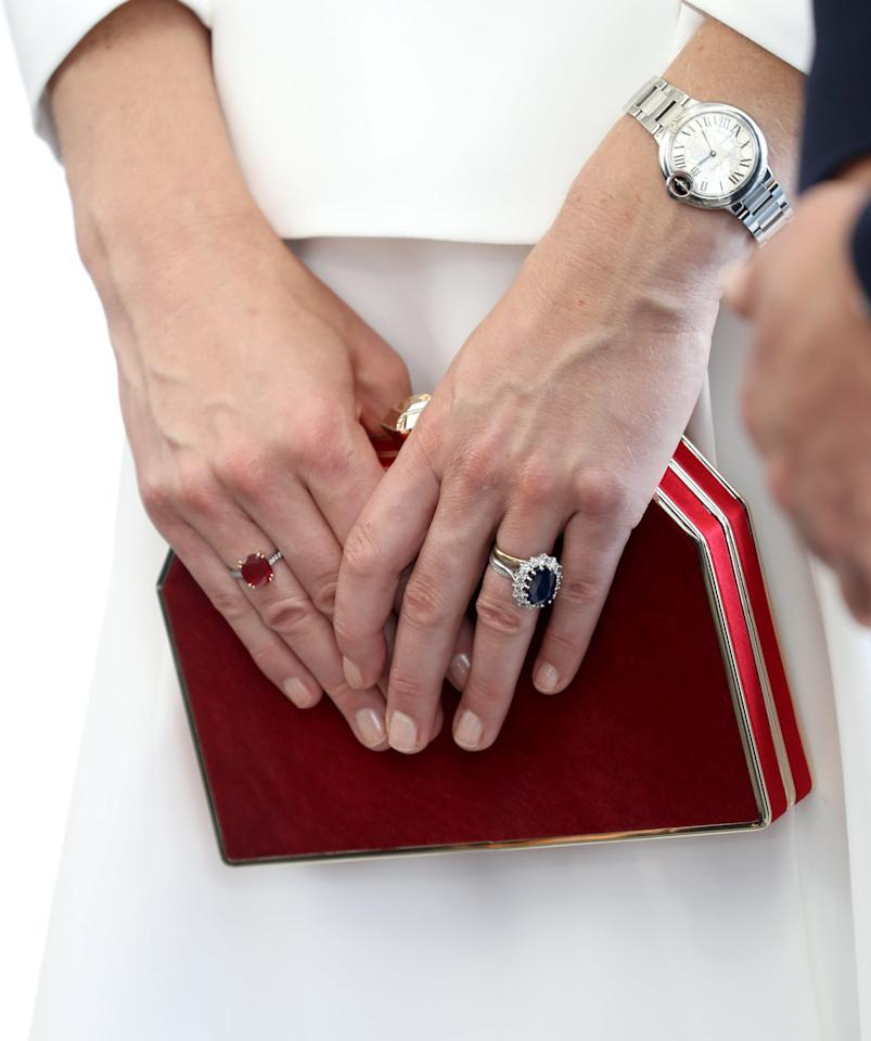"""<p>Princess Diana actually figures prominently into both of her son's ring choices. The approximately <a href=""""https://www.popsugar.com/fashion/Kate-Middleton-Engagement-Ring-44162099"""" class=""""ga-track"""" data-ga-category=""""Related"""" data-ga-label=""""http://www.popsugar.com/fashion/Kate-Middleton-Engagement-Ring-44162099"""" data-ga-action=""""In-Line Links"""">$50,000 12-carat sapphire and diamond ring</a> Prince William gave to Kate Middleton was his late mother's engagement ring from Prince Charles. </p>"""