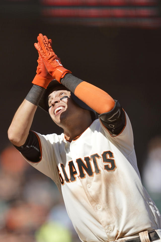 San Francisco Giants' Mauricio Dubon reacts after hitting a solo home run against the Colorado Rockies during the seventh of a baseball game Thursday, Sept. 26, 2019, in San Francisco. (AP Photo/Tony Avelar)