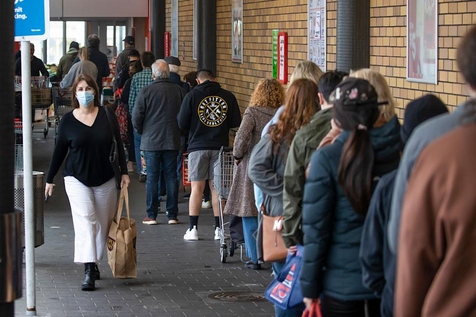 Shoppers lineup to enter a supermarket in Auckland, New Zealand, following the lockdown announcement. Source: New Zealand Herald via AP