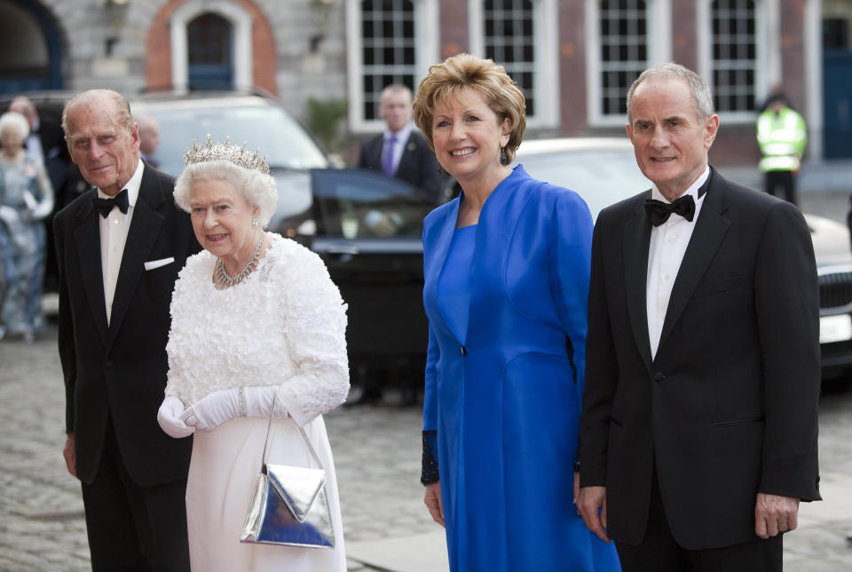 DUBLIN, IRELAND - MAY 18:  (NO UK SALES FOR 28 DAYS) Irish President Mary McAleese (2nd R) and husband Martin McAleese (R) greet Queen Elizabeth II and Prince Philip, Duke of Edinburgh as they arrive for a State Dinner on May 18, 2011 in Dublin, Ireland. The Duke and Queen's visit to Ireland is the first by a monarch since 1911. (Photo by Samir Hussein/WireImage)