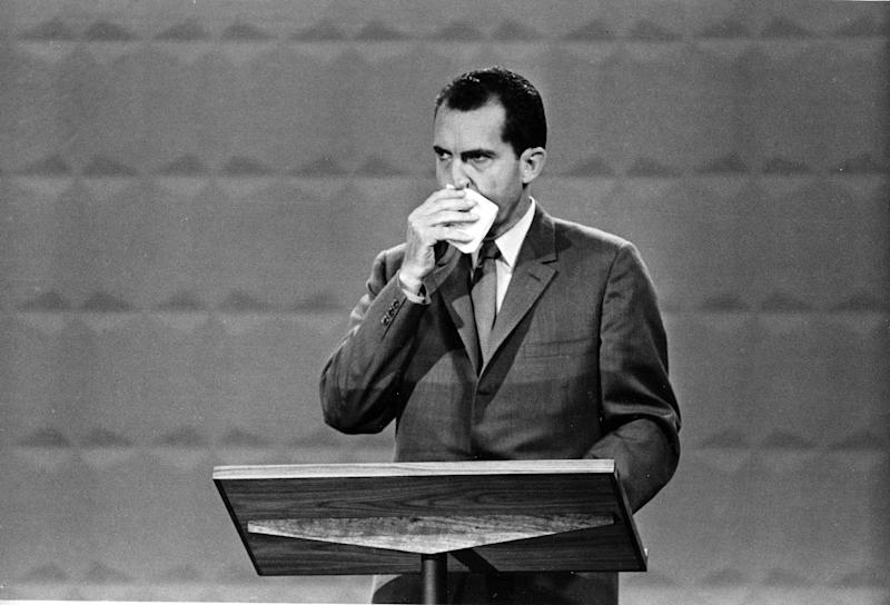 "FILE - This Sept. 26, 1960 black-and-white file photo shows Republican presidential candidate Vice President Richard M. Nixon wipes his face with a handkerchief during the nationally televised with Democratic nominee Sen. John F. Kennedy, in Chicago, Ill., Sept. 26, 1960. In presidential politics, everybody's searching for ""the moment."" The campaigns don't know when or how it will come, but they watch for something _ awkward words or an embarrassing image _ that can break through and become the defining symbol of the other guy's flaws. Now all eyes are on the series of three presidential debates that starts Wednesday.  (AP Photo, File)"