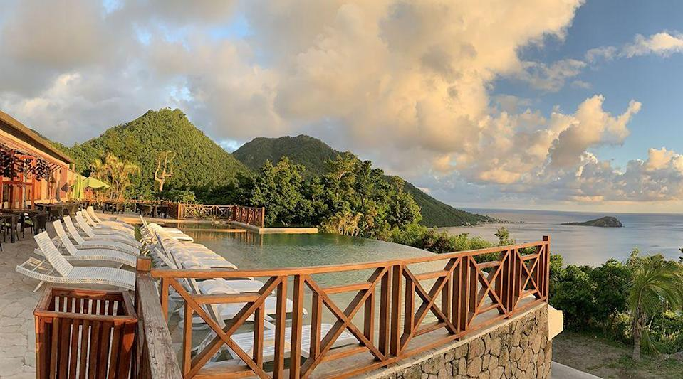 """<p>We can totally see ourselves diving into this beauty of <a href=""""https://junglebaydominica.com/"""" rel=""""nofollow noopener"""" target=""""_blank"""" data-ylk=""""slk:an infinity pool"""" class=""""link rapid-noclick-resp"""">an infinity pool</a>, which overlooks the Caribbean Sea and Scott's Head, the most southern tip of lush Dominica.</p>"""