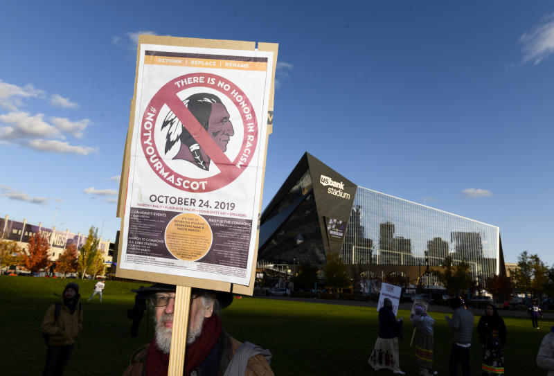 Protestors gathered outside of the Vikings home stadium to pressure owner Dan Snyder to change the Redskins name and mascot. (Stephen Maturen/Getty Images)