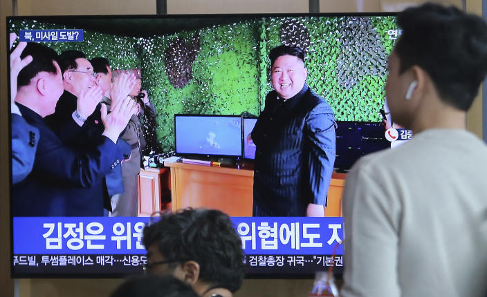 FILE - In this May 5, 2019, file photo, people watch a TV showing a photo of North Korean leader Kim Jong Un during a news program reporting North Korea's missile launch, at the Seoul Railway Station in Seoul, South Korea. North Korea's test of what appears to be new short-range ballistic missile may not have been a direct threat to the United States, but experts warn it's almost certainly an omen of bigger problems on the horizon.(AP Photo/Ahn Young-joon, File)