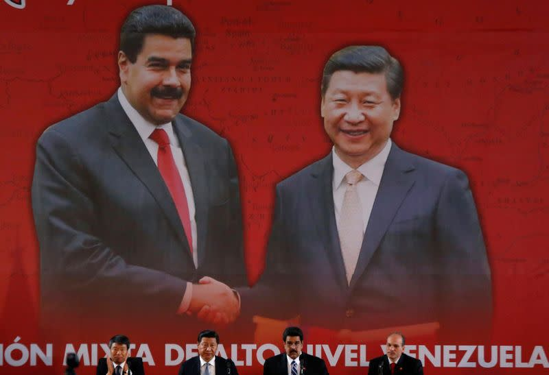 FILE PHOTO: China's President Xi and Venezuela's President Maduro attend a signing ceremony in Caracas