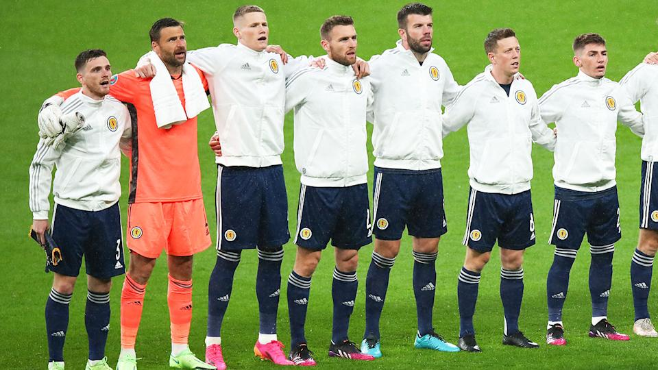 The Scotland team, pictured here singing the National Anthem before their clash with England.
