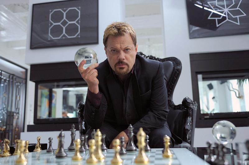 """This undated publicity photo released by Muse/IFC shows Eddie Izzard, as crime lord Tannhauser, playing a little game of chess with someone known as God in IFC's new action comedy """"Bullet In The Face."""" The series mixes darkly madcap humor, a silly but sadistic antihero and lots of violence in a stew that even Spencer is hard-pressed to define. (AP Photo/Muse/IFC, Philippe Bosse)"""