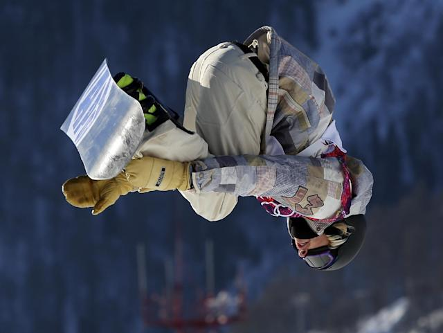 United States' Sage Kotsenburg takes a jump during the men's snowboard slopestyle semifinal at the Rosa Khutor Extreme Park, at the 2014 Winter Olympics, Saturday, Feb. 8, 2014, in Krasnaya Polyana, Russia. (AP Photo/Sergei Grits)