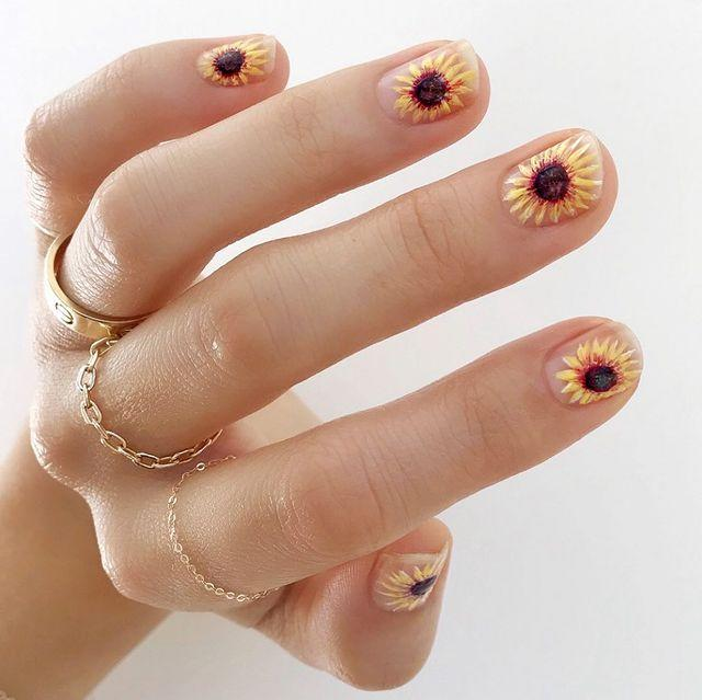 "<p>Go all Van Gogh on your summer nail art with hand-painted sunflowers.</p><p><a href=""https://www.instagram.com/p/B_sj1BSDl6b/?utm_source=ig_embed&utm_campaign=loading"" rel=""nofollow noopener"" target=""_blank"" data-ylk=""slk:See the original post on Instagram"" class=""link rapid-noclick-resp"">See the original post on Instagram</a></p>"