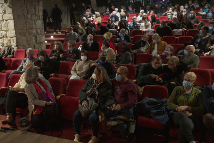 The audience waits on opening night at the Khan Theater during a performance where all guests were required to show proof of receiving a COVID-19 vaccination or full recovery from the virus, in Jerusalem, Tuesday, Feb. 23, 2021. (AP Photo/Maya Alleruzzo)