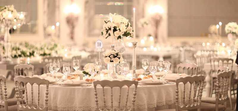 A very elegant dining room prepared for dinner service.