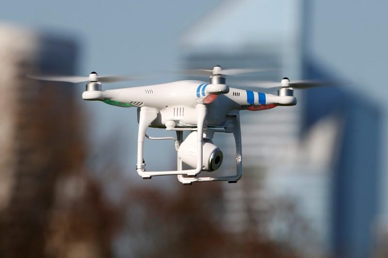 A 'Phantom 2' drone by DJI company flies during the 4th Intergalactic Meeting of Phantom's Pilots (MIPP) in an open secure area in the Bois de Boulogne, Paris, in this March 16, 2014 file photo. REUTERS/Charles Platiau/Files