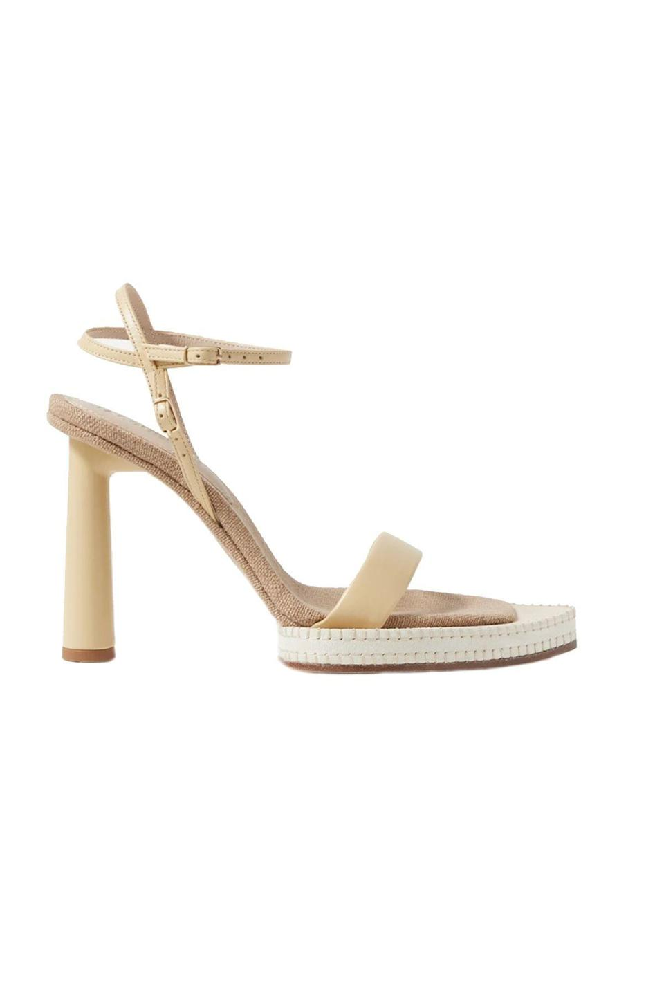 """<p><strong>Jacquemus</strong></p><p>net-a-porter.com</p><p><strong>$700.00</strong></p><p><a href=""""https://go.redirectingat.com?id=74968X1596630&url=https%3A%2F%2Fwww.net-a-porter.com%2Fen-us%2Fshop%2Fproduct%2Fjacquemus%2Fshoes%2Fhigh-heel%2Fnovio-leather-sandals%2F22527730565883580&sref=https%3A%2F%2Fwww.townandcountrymag.com%2Fstyle%2Ffashion-trends%2Fg36474527%2Fstatement-heels%2F"""" rel=""""nofollow noopener"""" target=""""_blank"""" data-ylk=""""slk:Shop Now"""" class=""""link rapid-noclick-resp"""">Shop Now</a></p><p>These ultra-sophisticated leather sandals are perfect for summer office days with a breezy white shirtdress. </p><p><strong>More: </strong><a href=""""https://www.townandcountrymag.com/style/fashion-trends/g36342991/best-white-dresses/"""" rel=""""nofollow noopener"""" target=""""_blank"""" data-ylk=""""slk:24 Essential White Dresses for Summer"""" class=""""link rapid-noclick-resp"""">24 Essential White Dresses for Summer</a></p>"""