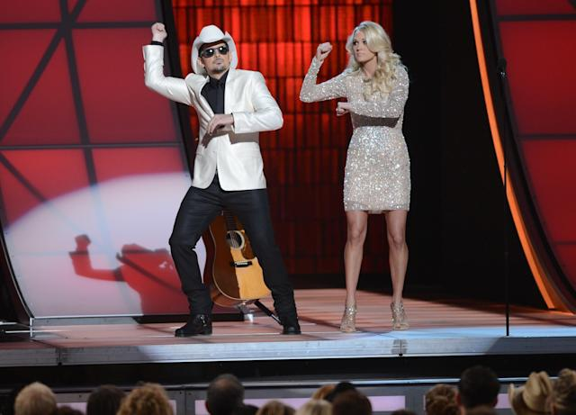 NASHVILLE, TN - NOVEMBER 01: (L-R) Co-hosts Brad Paisley and Carrie Underwood present during the 46th annual CMA Awards at the Bridgestone Arena on November 1, 2012 in Nashville, Tennessee. (Photo by Jason Kempin/Getty Images)