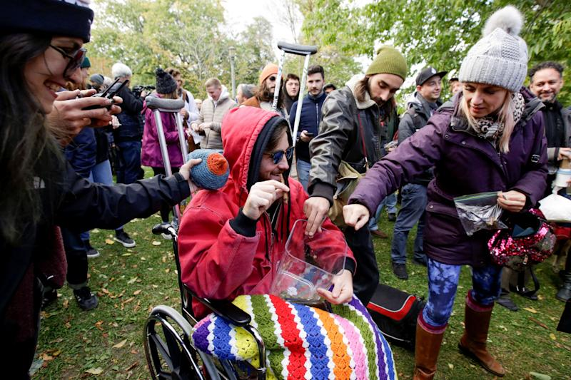 People contribute cannabis for a communal joint on the day Canada legalizes recreational marijuana, in Toronto, Ontario, Canada, October 17, 2018. REUTERS/Carlos Osorio