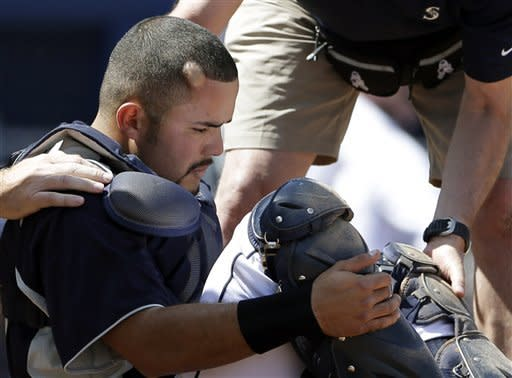 A welt forms on the side of the head of Seattle Mariners catcher Jesus Montero after being hit by the bat of Cleveland Indians' Francisco Lindor during the second inning in an exhibition spring training baseball game Saturday, March 23, 2013, in Peoria, Ariz. (AP Photo/Gregory Bull)