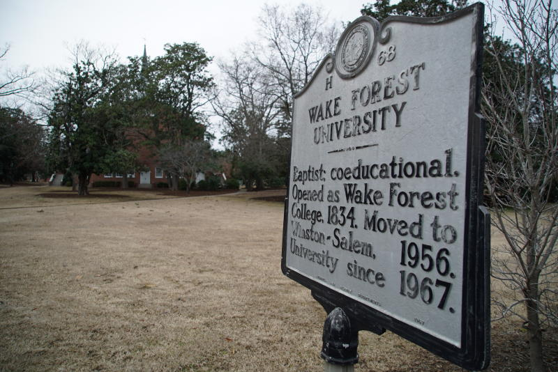 A historical marker stands on the former campus of Wake Forest College in Wake Forest, N.C., on Thursday, Feb. 20, 2020. The campus is now home to Southeastern Baptist Theological Seminary. (AP Photo/Allen G. Breed)