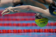 <p>Mitch Larkin of Australia starts in his heat of the men's 100-meter backstroke at the 2020 Summer Olympics, Sunday, July 25, 2021, in Tokyo, Japan. (AP Photo/Martin Meissner)</p>