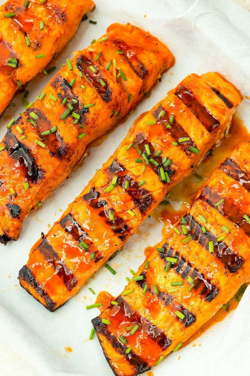 "<p>Salmon fillets get a kick from spicy Sriracha glaze.</p><p>Get the recipe from <a href=""https://www.delish.com/cooking/recipe-ideas/recipes/a47372/hot-shot-grilled-salmon-recipe/"" rel=""nofollow noopener"" target=""_blank"" data-ylk=""slk:Delish"" class=""link rapid-noclick-resp"">Delish</a>.</p>"