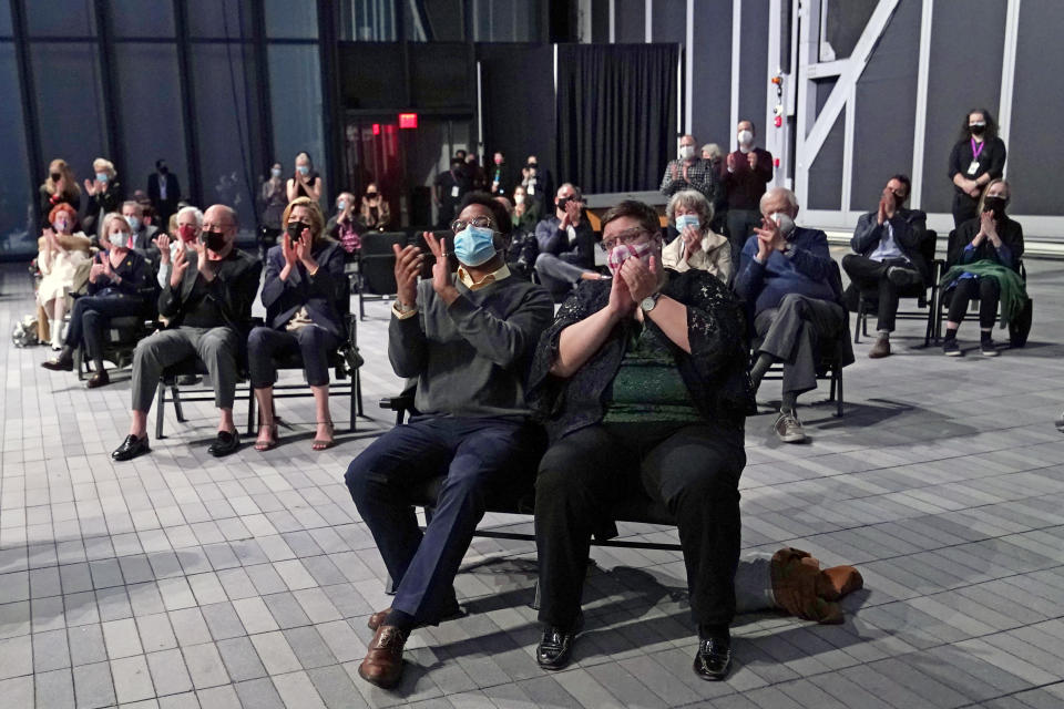 Members of an audience of 150 people applaud at the conclusion of a concert by the New York Philharmonic, which performed together for the first time since March 10, 2020, at The Shed in Hudson Yards, Wednesday, April 14, 2021, in New York. (AP Photo/Kathy Willens)