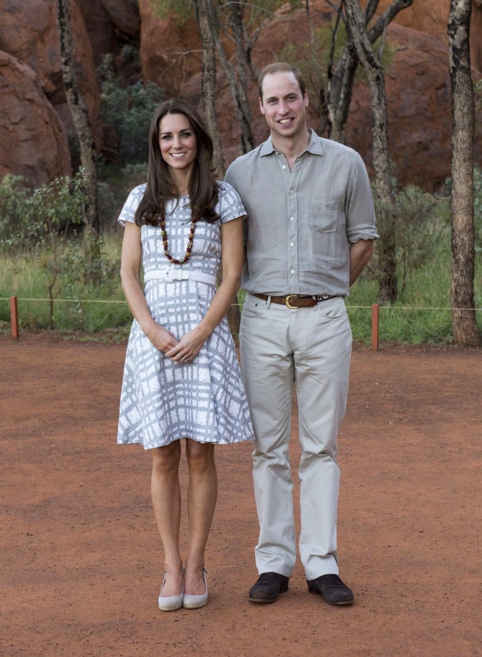 <p>Kate donned a chequered tea dress by Hobbs for a trip to Uluru, Australia accessorised with a white belt and grey suede wedges.</p><p><i>[Photo: PA]</i></p>