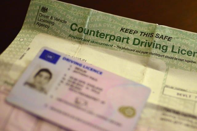 A UK driving licence shown beside a counterpart driving licence, London.