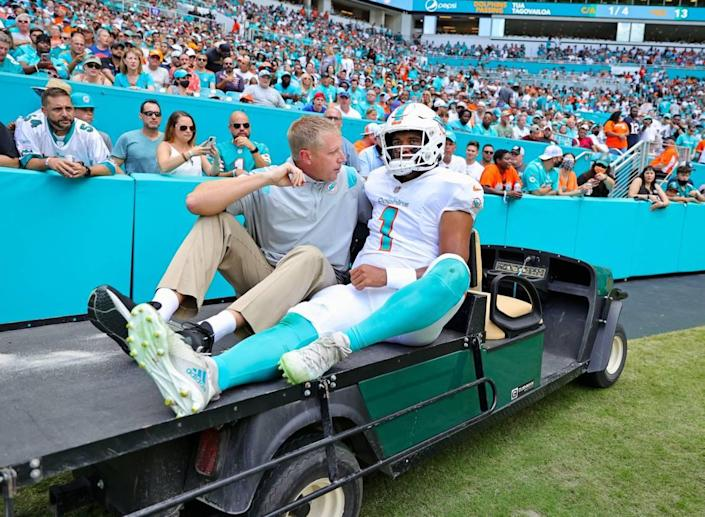 Miami Dolphins quarterback Tua Tagovailoa (1) carted out the field after getting injured in a play during first quarter of an NFL football game against the Buffalo Bills at Hard Rock Stadium on Sunday, September 19, 2021 in Miami Gardens, Florida.