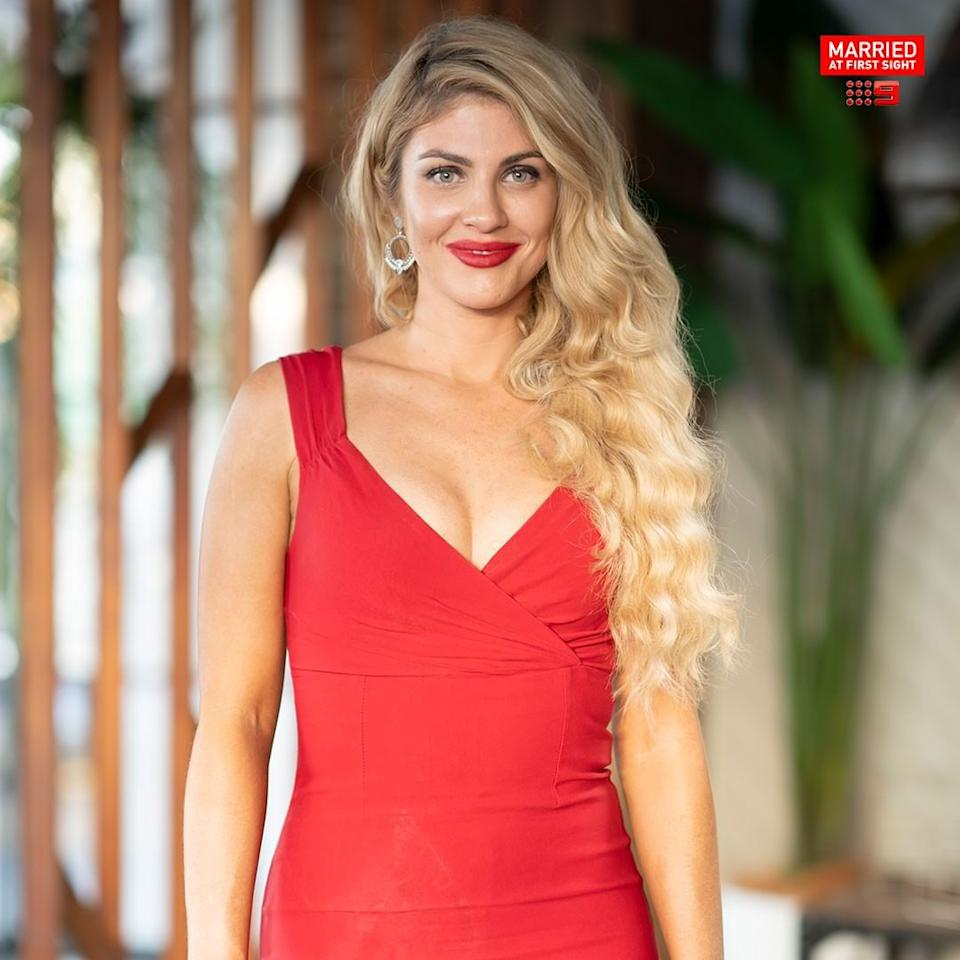 MAFS bride Booka Nile wearing a red dress and red lipstick. Photo: Channel Nine.