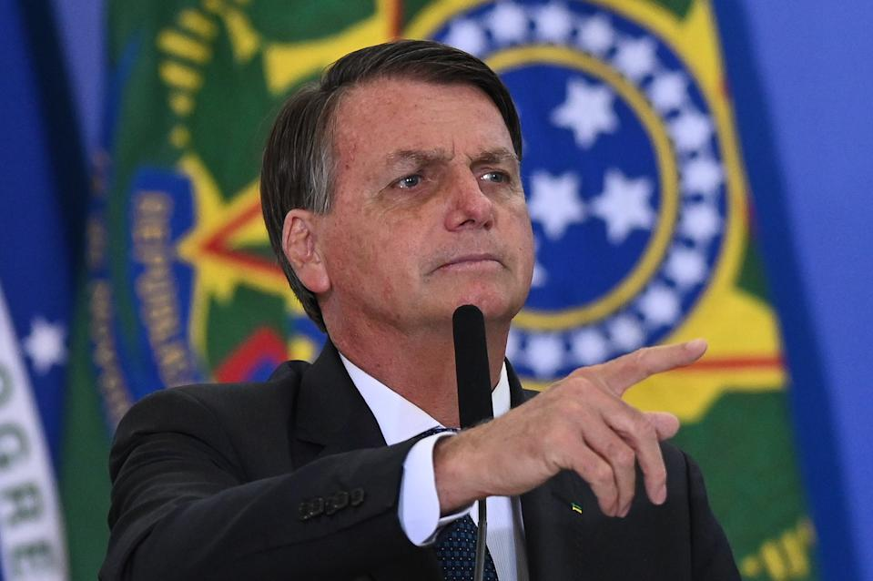 Brazil's president Jair Bolsonaro speaks during the swearing-in ceremony of the Brazil's Tourism Minister Gilson Machado, amidst the Coronavirus (COVID - 19) pandemic at Planalto Palace on December 17, 2020 in Brasilia.  (Photo by Andre Borges/NurPhoto via Getty Images)