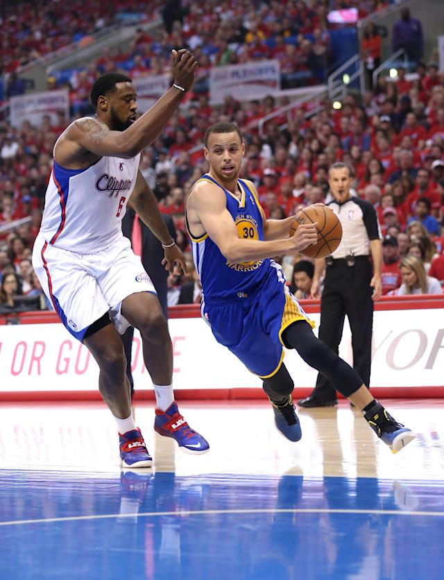 LOS ANGELES, CA - MAY 03: Stephen Curry #30 of the Golden State Warriors drives past DeAndre Jordan #6 of the Los Angeles Clippers in Game Seven of the Western Conference Quarterfinals during the 2014 NBA Playoffs at Staples Center on May 3, 2014 in Los Angeles, California. NOTE TO USER: User expressly acknowledges and agrees that, by downloading and or using this photograph, User is consenting to the terms and conditions of the Getty Images License Agreement. (Photo by Stephen Dunn/Getty Images)
