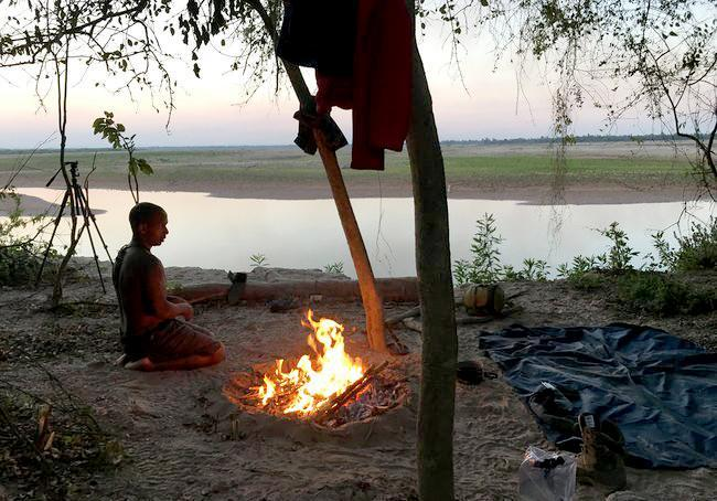 Shon warms up by the fires in the Bush Plains of Northern Argentina. (Credit: Discovery)