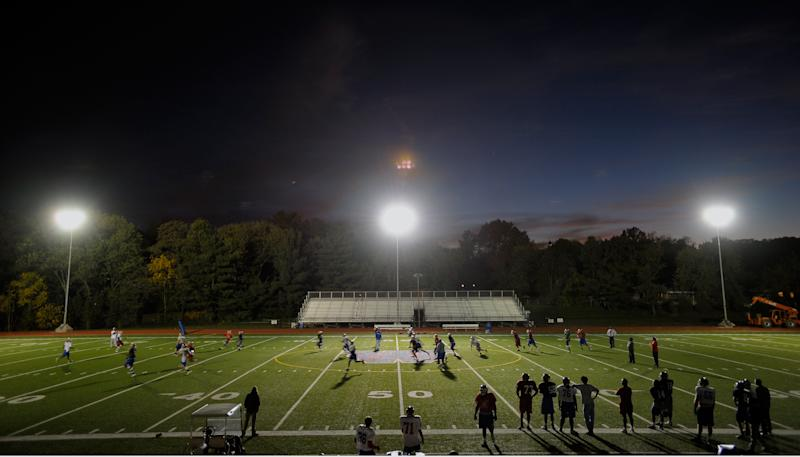 ALEXANDRIA VA- OCTOBER 28 : T.C. Williams Football team conducts practice under a set of tempary lights. The Team is hosting the first night football game in its 45-year history. To do so, the school is paying $24,000 to have an Iowa company bring in five sets of lights at T.C. Williams High School in Alexandria VA, October 28, 2010. (Photo by John McDonnell/The Washington Post via Getty Images)