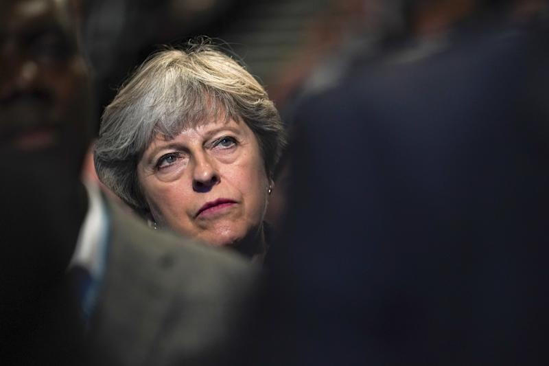 """""""I think it's up to America what gun laws they put in place,"""" Theresa May said Tuesday. (Christopher Furlong via Getty Images)"""
