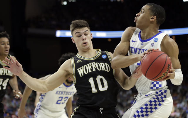 Wofford's Nathan Hoover (10) guards Kentucky's Keldon Johnson, right, as he looks to pass during the first half of a second-round game in the NCAA mens college basketball tournament in Jacksonville, Fla., Saturday, March 23, 2019. (AP Photo/John Raoux)